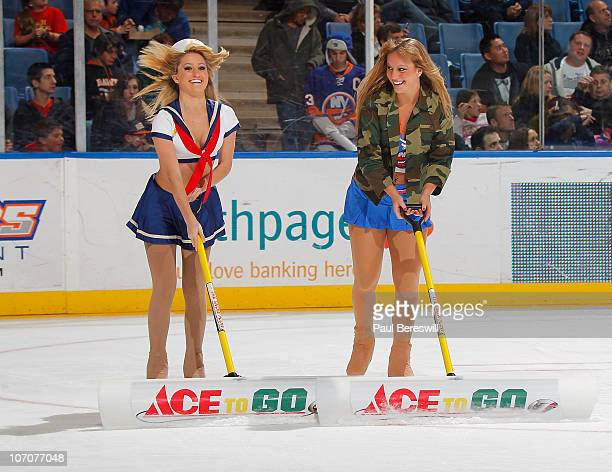 New York Islanders ice girls scrape the ice during a timeout as they wear military style outfits in honor of military night during a hockey game...