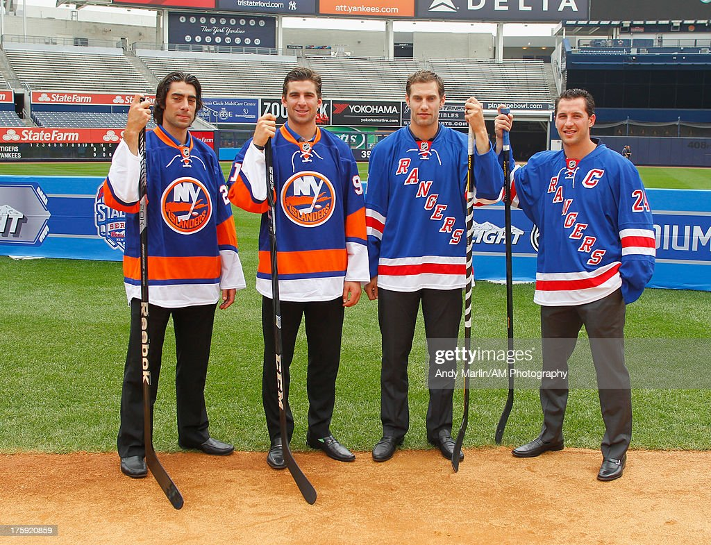New York Islanders players <a gi-track='captionPersonalityLinkClicked' href=/galleries/search?phrase=Matt+Moulson&family=editorial&specificpeople=3365493 ng-click='$event.stopPropagation()'>Matt Moulson</a> and <a gi-track='captionPersonalityLinkClicked' href=/galleries/search?phrase=John+Tavares&family=editorial&specificpeople=601791 ng-click='$event.stopPropagation()'>John Tavares</a> and New York Rangers players Dan Girardi and <a gi-track='captionPersonalityLinkClicked' href=/galleries/search?phrase=Ryan+Callahan&family=editorial&specificpeople=809690 ng-click='$event.stopPropagation()'>Ryan Callahan</a> pose for a photo during the 2014 NHL Stadium Series Media Availabilty at Yankee Stadium on August 8, 2013 in New York City.