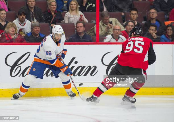 New York Islanders Right Wing Joshua HoSang battle for possession of the puck against Ottawa Senators Center Matt Duchene during the first period of...
