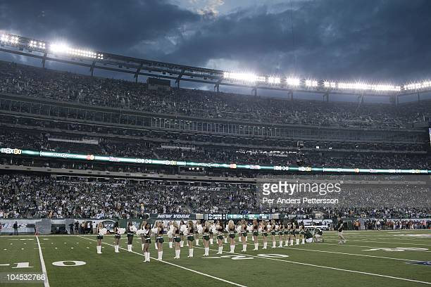 New York Jets cheer leaders entertain before a game against Baltimore Ravens during the opening game at the new Meadowlands stadium on September 13...