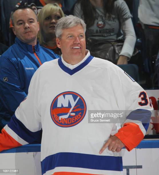 New York Jets coach Rex Ryan gets ready to drop the ceremonial puck between Brenden Morrow of the Dallas Stars and Doug Weight of the New York...