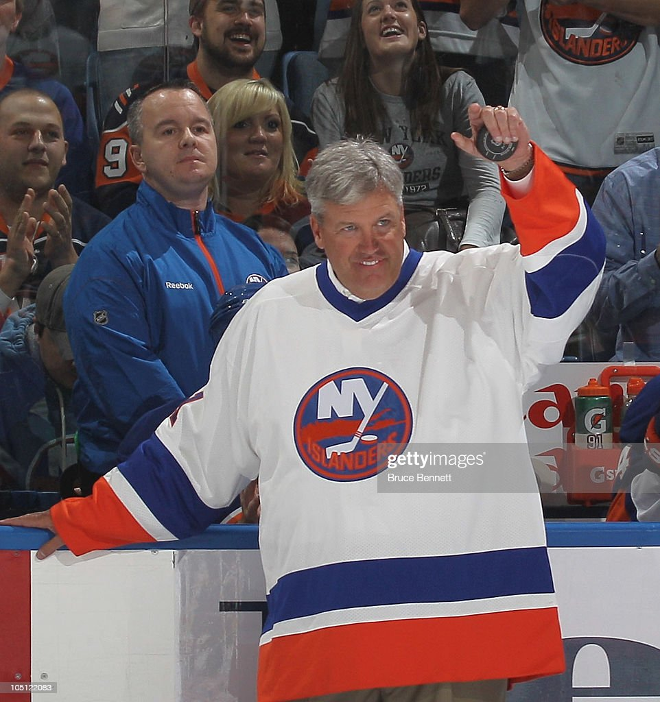 New York Jets coach <a gi-track='captionPersonalityLinkClicked' href=/galleries/search?phrase=Rex+Ryan&family=editorial&specificpeople=2358658 ng-click='$event.stopPropagation()'>Rex Ryan</a> gets ready to drop the ceremonial puck between Brenden Morrow #10 of the Dallas Stars and Doug Weight #93 of the New York Islanders prior to the Islanders home opener at the Nassau Coliseum on October 9, 2010 in Uniondale, New York.