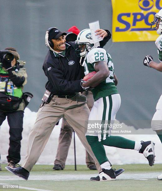 New York Jets' cornerback Justin Miller is congratulated by head coach Herm Edwards after scoring on a 95yard kickoff return late in the fourth...