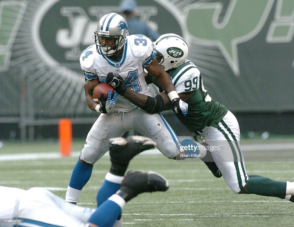 New York Jets defensive end Bryan Thomas makes a diving tackle on Detroit Lions running back Kevin Jones on Sunday October 22 2006 at the Meadowlands...