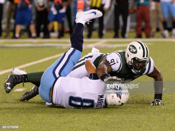 New York Jets defensive end Sheldon Richardson takes Tennessee Titans quarterback Marcus Mariota to the turf during the preseason football game...
