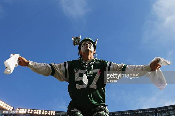 A New York Jets fan cheers during their game against the Philadelphia Eagles during their game at MetLife Stadium on September 27 2015 in East...
