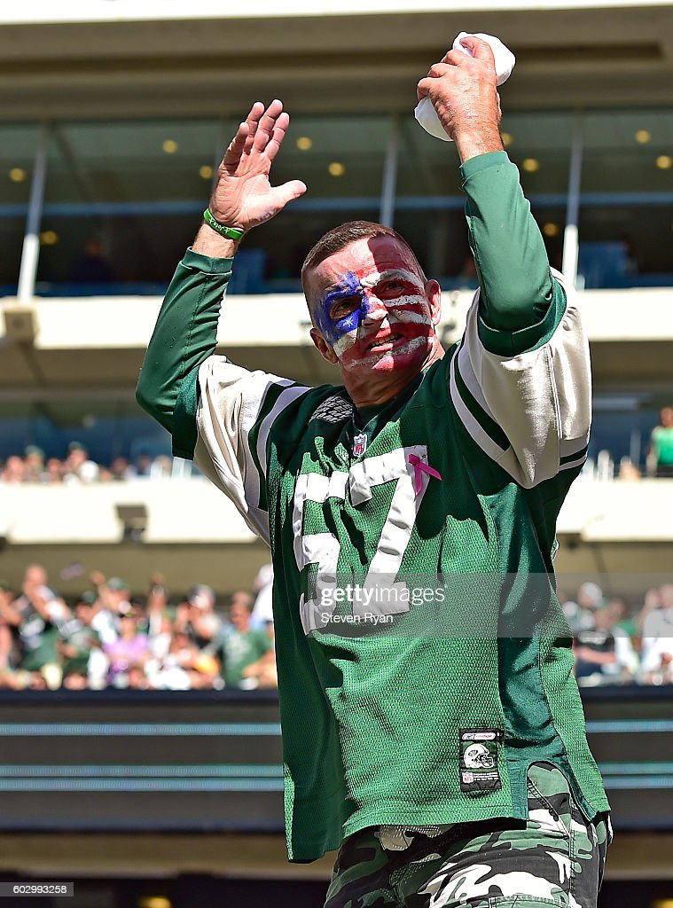 A New York Jets fan cheers on his team against the Cincinnati Bengals during the fourth quarter at MetLife Stadium on September 11, 2016 in East Rutherford, New Jersey. The Cincinnati Bengals defeated the New York Jets 23-22.