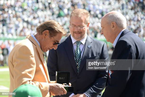 New York Jets Hall of Famer Joe Namath receives his ring during the Hall of Fame Ring of Excellence ceremony prior to the start of the Jacksonville...