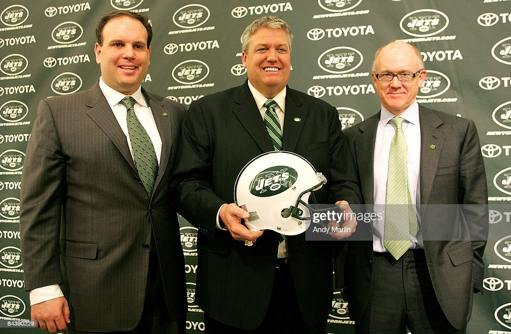 New York Jets Head Coach Rex Ryan (C) Owner Woody Johnson (R) and General Manager Mike Tannenbaum pose for a photo at a press conference naming Ryan as the new Head Coach of the New York Jets at the Atlantic Health Jets Training Center on January 21, 2009 in Florham Park, New Jersey.