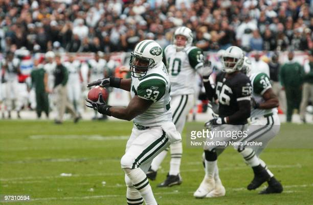 New York Jets' Jerald Sowell catches the ball and goes on to run it in to the end zone for the touchdown in the second quarter of the AFC divisional...