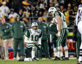 New York Jets' offensive tackle Jason Fabini looks on as quarterback Chad Pennington screams after being sacked during the first half of the AFC...