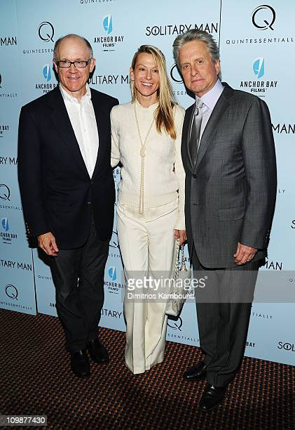 New York Jets owner Woody Johnson wife Suzanne Johnson and actor Michael Douglas attend the premiere of Solitary Man at Cinema 2 on May 11 2010 in...