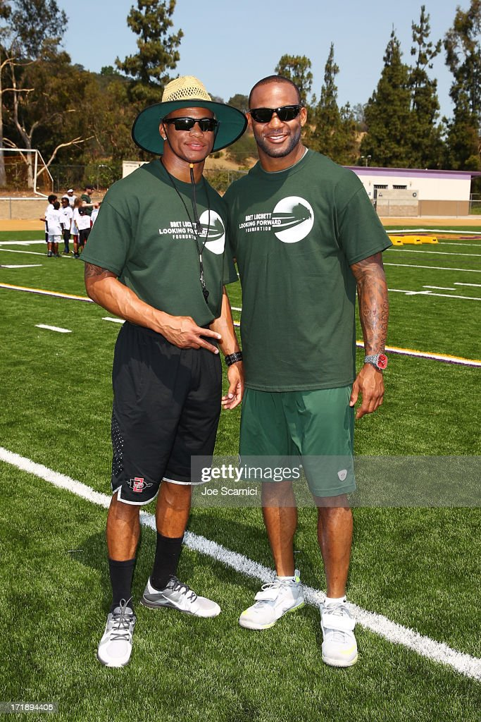 New York Jets player Bret Lockett (R) and brother Kolin Lockett host charity football camp at Diamond Bar High School on June 29, 2013 in Diamond Bar, California.
