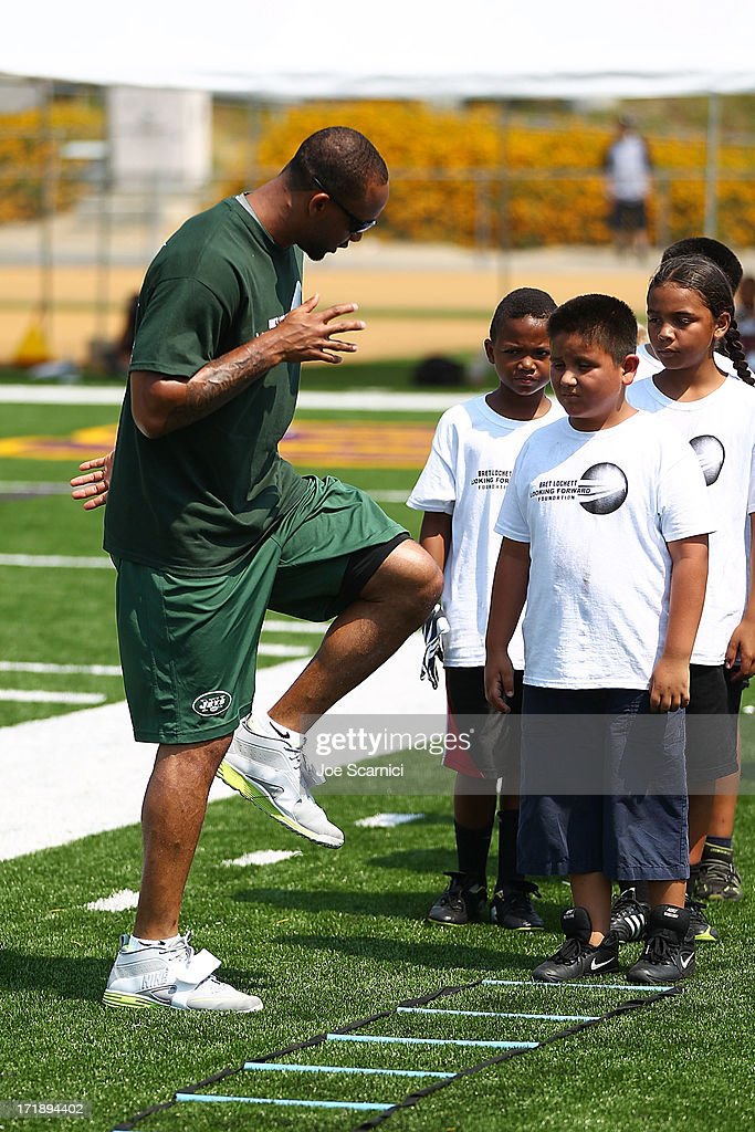New York Jets player Bret Lockett hosts a charity football camp at Diamond Bar High School on June 29, 2013 in Diamond Bar, California.