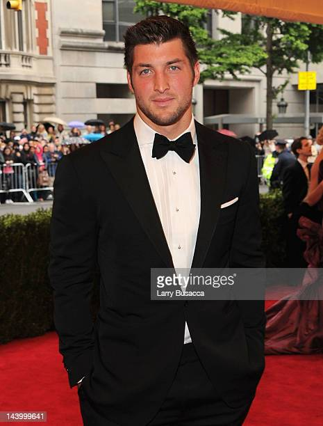 New York Jets QB Tim Tebow attends the 'Schiaparelli And Prada Impossible Conversations' Costume Institute Gala at the Metropolitan Museum of Art on...