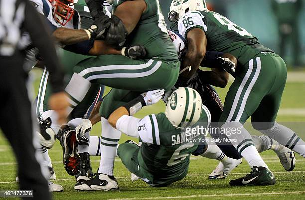 New York Jets quarterback Mark Sanchez fumble in the first half when the New York Jets played the New England Patriots Sanchez smacks into lineman...