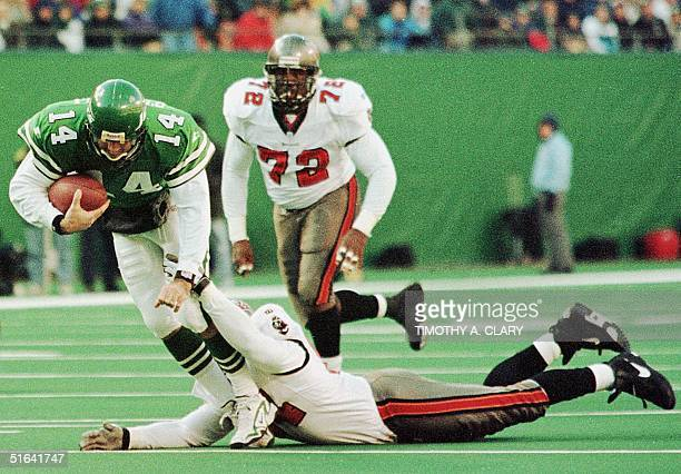 New York Jets quarterback Neil O'Donnell drags Tampa Bay Buccaneers defensive end Steve White as O'Donnell runs for a first down in the first quarter...