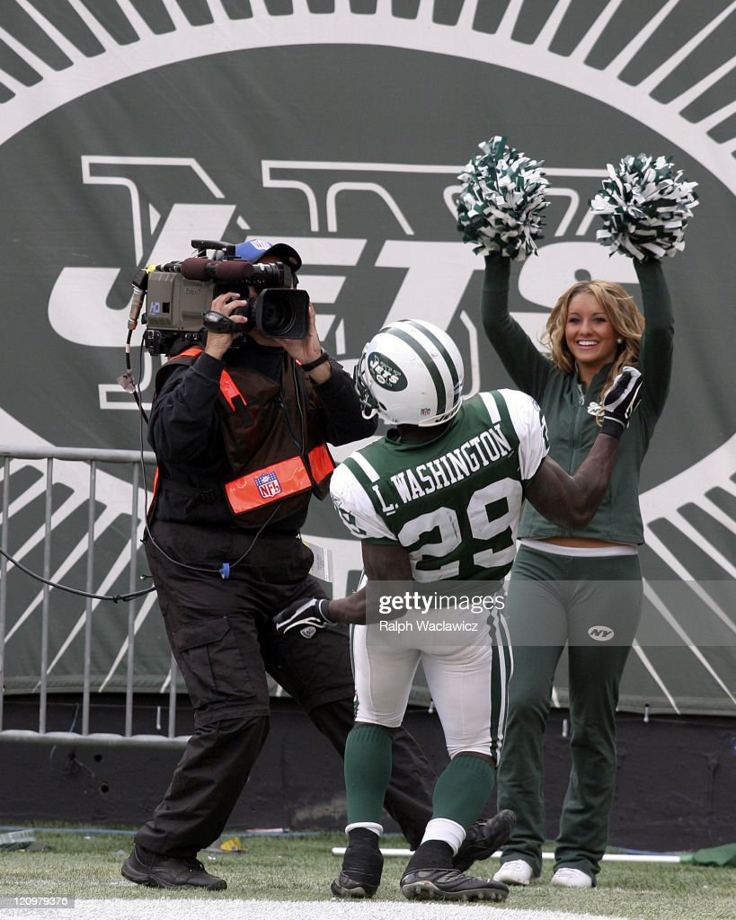 New York Jets rookie runningback Leon Washington sings to the camera and the flag girl after scoring a touchdown during their 31 to 24 victory over...