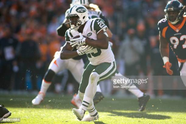 New York Jets running back Bilal Powell runs the ball during the New York Jets vs Denver Broncos football game at Sports Authority Field in Denver CO...