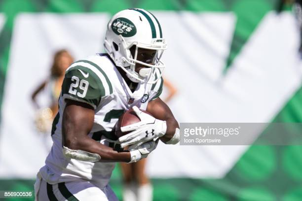 New York Jets Running Back Bilal Powell takes a hand off from Quarterback Josh McCown during the first half of a regular season NFL game between the...