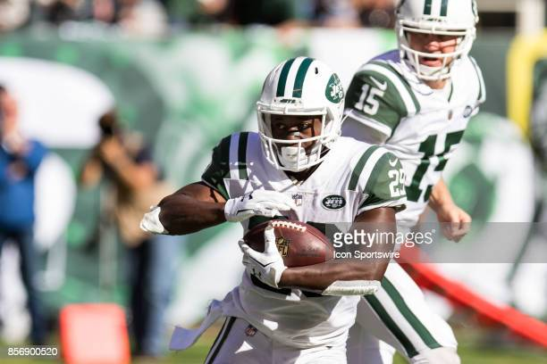 New York Jets Running Back Bilal Powell takes a hand off from New York Jets Quarterback Josh McCown during the second half of a regular season NFL...