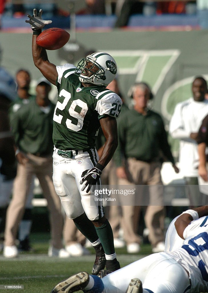 New York Jets running back Leon Washington goes up for a ball on the final play of the game against the Indianapolis Colts at Giants Stadium East...
