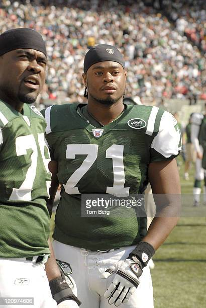 New York Jets T Adrian Jones and Jets OL Wade Smith on the sidelines during the Indianapolis Colts vs New York Jets game on October 1 2006 at the...