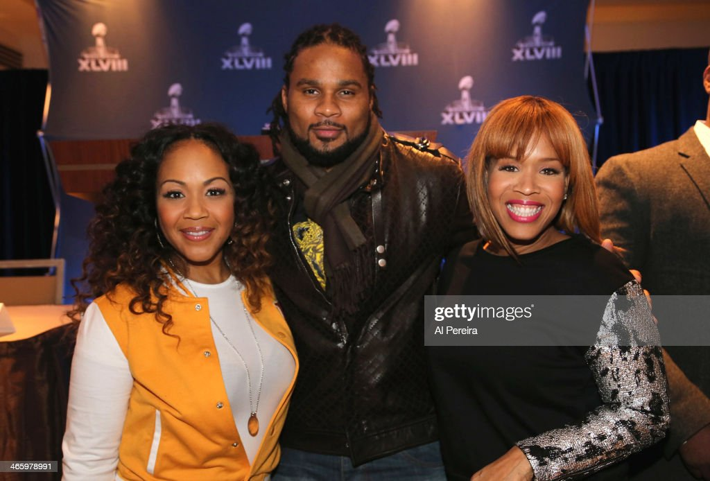 New York Jets Wide Receiver and NFL Players Choir member Josh Cribbs (C) poses with <a gi-track='captionPersonalityLinkClicked' href=/galleries/search?phrase=Erica+Campbell&family=editorial&specificpeople=827874 ng-click='$event.stopPropagation()'>Erica Campbell</a> (L) and Tina Campbell (R) of the Gospel Duo Mary Mary at the Super Bowl Gospel Celebration Concert Press Conference at Super Bowl XLVIII Media Center, Sheraton Times Square on January 30, 2014 in New York City.