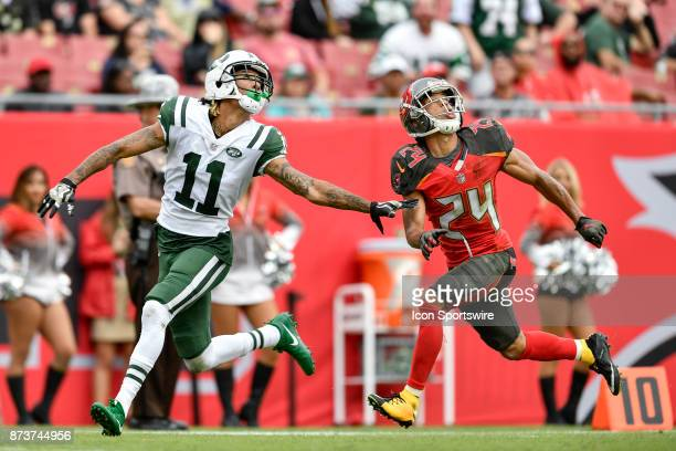 New York Jets wide receiver Robby Anderson and Tampa Bay Buccaneers cornerback Brent Grimes track the ball during the second half of an NFL game...