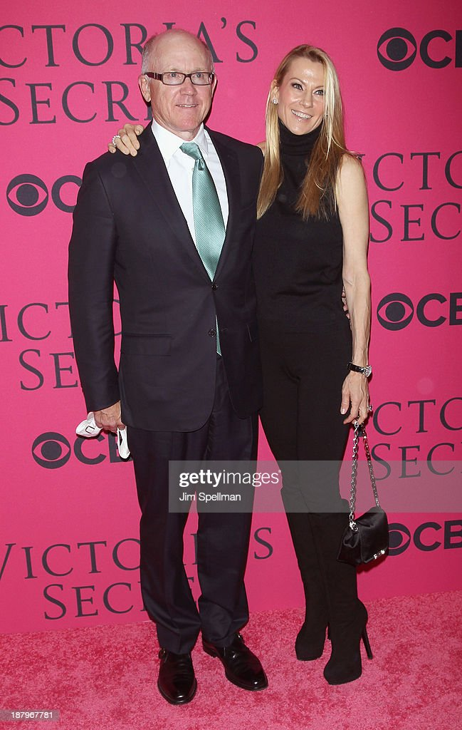 New York Jets Woody Johnson and guest attend the 2013 Victoria's Secret Fashion Show at Lexington Avenue Armory on November 13, 2013 in New York City.