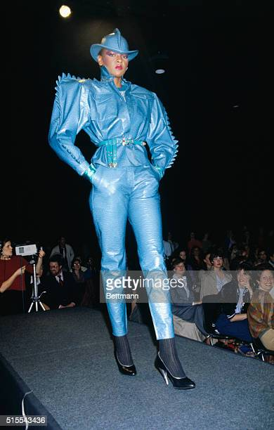 Kansai Yamamoto for Cygne Designs takes a bold approach to FallWinter 19791980 with this blue embossed leather dragon sleeved rain suit with matching...