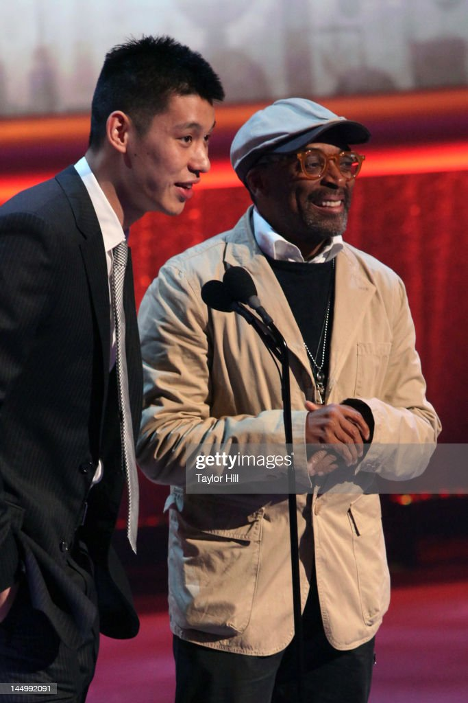 New York Knick Jeremy Lin and director Spike Lee present the 'Sports Web' winner to Skip Bayless at the 16th Annual Webby Awards at Hammerstein Ballroom on May 21, 2012 in New York City.