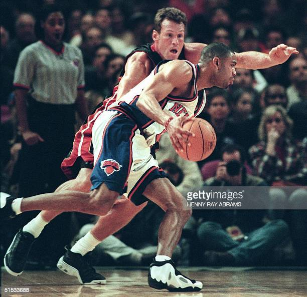 New York Knicks' Allan Houston drives by the Miami Heat's Dan Majerle in the first quarter at Madison Square Garden in New York 14 November 1999 AFP...