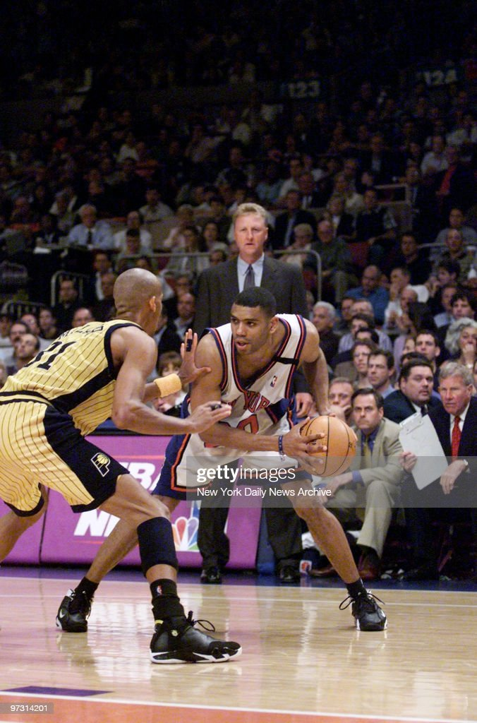 New York Knicks' Allan Houston tries to work his way around Indiana Pacers' Reggie Miller in Game 6 of the Eastern Conference Finals at Madison...