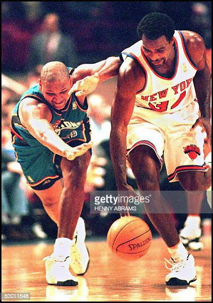 New York Knicks' Charles Oakley chases down a loose ball in front of the Detroit Pistons' Terry Mills during the first quarter at Madison Square...