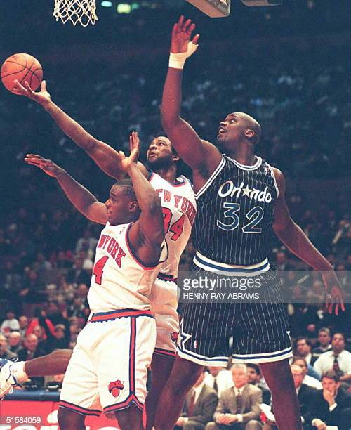 New York Knicks' Charles Oakley grabs a defensive rebound from teammate Anthony Mason and the Orlando Magic's Shaquille O'Neal in the second quarter...