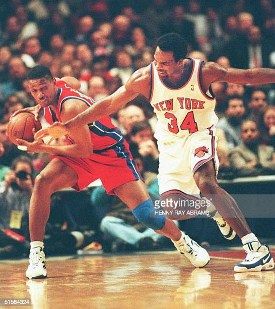 New York Knicks' Charles Oakley tries to steal the ball from the Detroit Pistons' Otis Thorpe during the second quarter of their game at Madison...