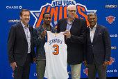 New York Knicks coach Jeff Hornacek Knicks newest player Brandon Jennings Knicks President Phil Jackson and General Manager Steven Mills pose at the...