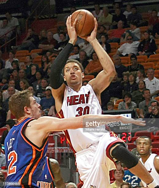 New York Knicks' David Lee guards Miami Heat's Michael Beasly during the first quarter of a NBA basketball game at American Airlines Arena in Miami...