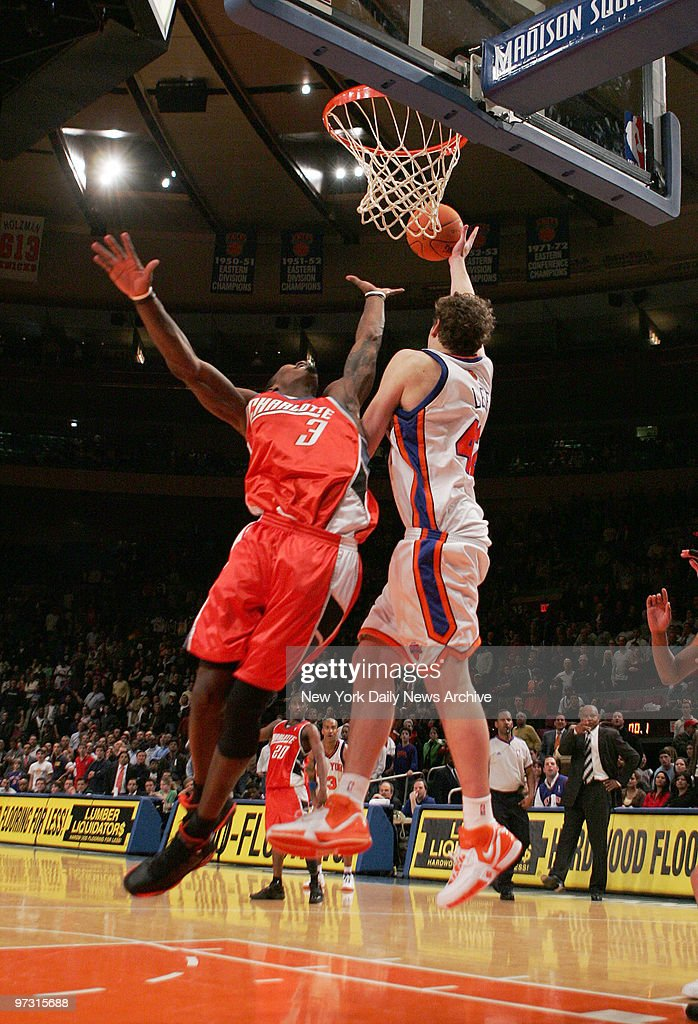 New York Knicks' David Lee tips the ball in on a long inbounds pass at the buzzer in double overtime for the winning basket giving the Knicks a...