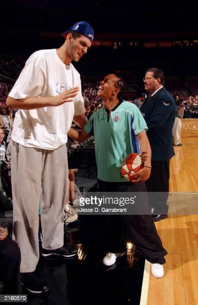 New York Knicks draft pick Slavko Vranes jokes with Teresa Weatherspoon of the New York Liberty during the game against the Detroit Shock on June 27...