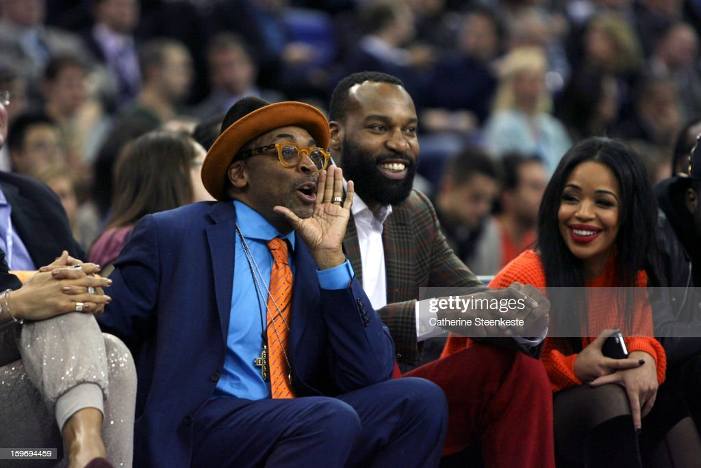 New York Knicks fan Spike Lee and Baron Davis of the New York Knicks are laughing during a game between the New York Knicks and the Detroit Pistons at the O2 Arena on January 17, 2013 in London, England.