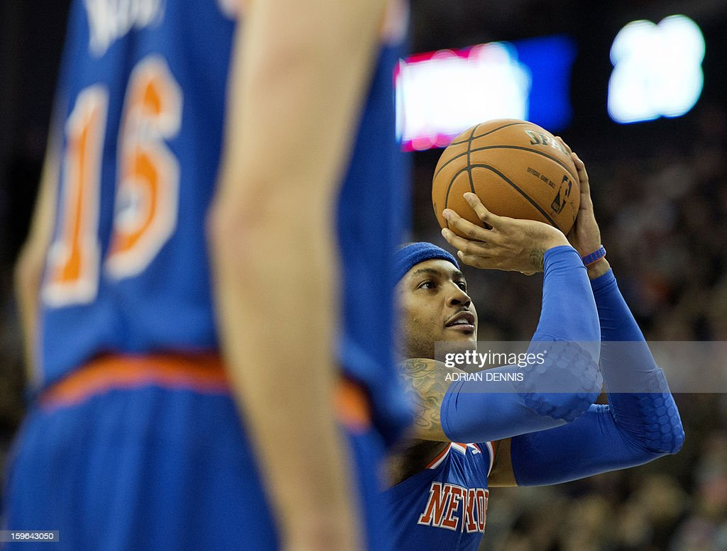 New York Knicks' forward Carmelo Anthony (R) takes a free throw against the Detroit Pistons during their NBA basketball game at the O2 Arena in London on January 17, 2013.