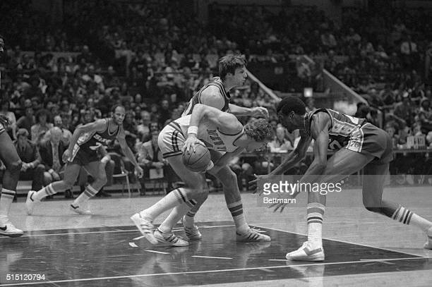 New York Knicks Glen Gondrezick with ball in hand try's to drive past 76'ers Harvey Catchings in first period of play here 12/25 at Madison Square...
