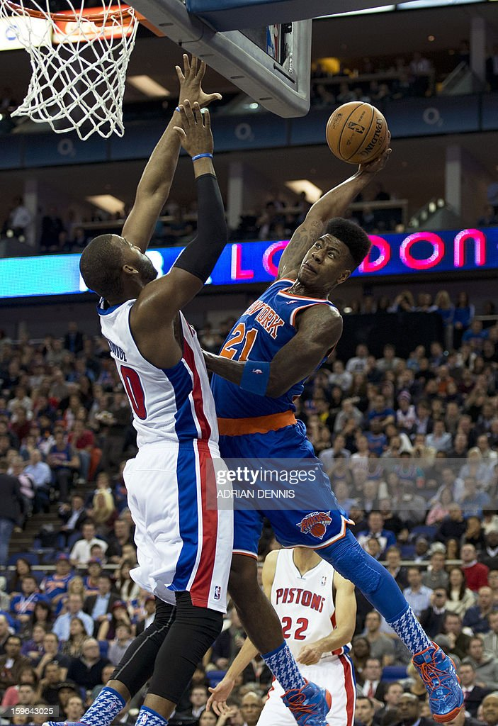 New York Knicks' guard Iman Shumpert (R) attempts to dunk the ball over Detroit Pistons' centre Greg Munroe (L) during their NBA basketball game at the O2 Arena in London on January 17, 2013.