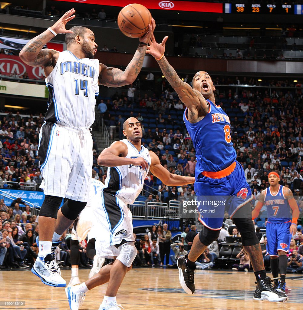 New York Knicks guard J.R. Smith (8) tries to steal a rebound from Orlando Magic guard Jameer Nelson (14) during game action at the Amway Center in Orlando, Florida, Saturday, January 5, 2013. The Knicks defeated the Magic, 114-106.