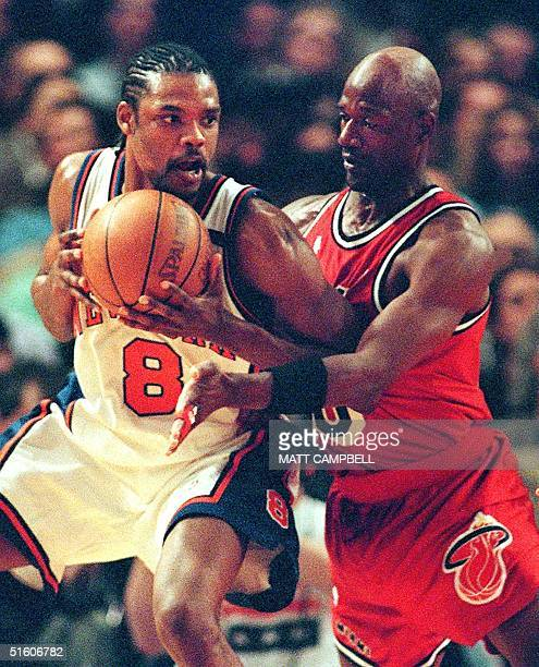 New York Knicks guard Latrell Sprewell tries to keep the ball away from Miami Heat guard Terry Porter in the first quarter 05 May 1999 at Madison...