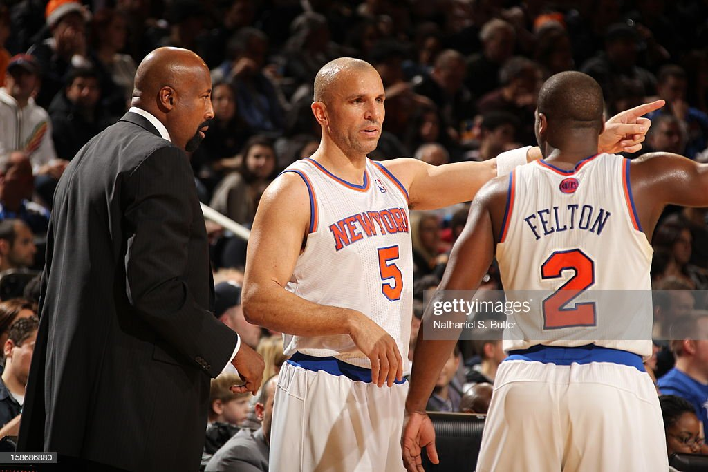 New York Knicks head coach Mike Woodson talks with Jason Kidd #5 and Raymond Felton #2 of the New York Knicks on December 23, 2012 at Madison Square Garden in New York City.