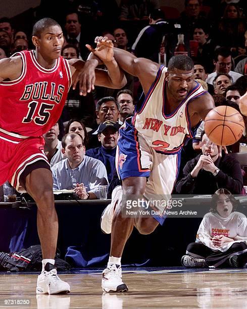 New York Knicks' Larry Johnson and Chicago Bulls' Ron Artest chase a loose ball during game at Madison Square Garden The Knicks won the game 9588