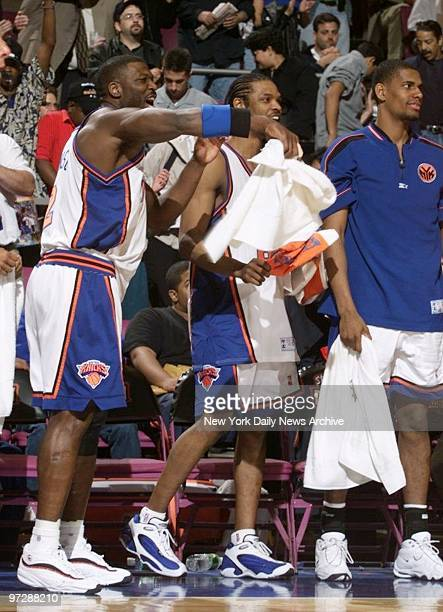 New York Knicks Larry Johnson and Latrell Sprewell celebrate on the bench at the end of the game against the Miami Heat at Madison Square Garden...